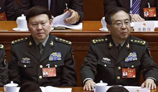 FILE - In this March 8, 2017, photo, Fang Fenghui, right, the then-chief of the general staff of the Chinese People's Liberation Army, right, and Zhang Yang, left, the then-head of China's People's Liberation Army (PLA) political affairs department attend the China's National People's Congress (NPC) at the Great Hall of the People in Beijing. Chinese state media say a former chief of the People's Liberation Army's joint staff department has been referred to military prosecutors on suspicion of bribery. The official Xinhua News Agency says Fang Fenghui's case was transferred Tuesday, Jan. 9, 2018 to the PLA's criminal prosecution body, a move that virtual ensures his conviction at court martial. (AP Photo/Andy Wong, File)