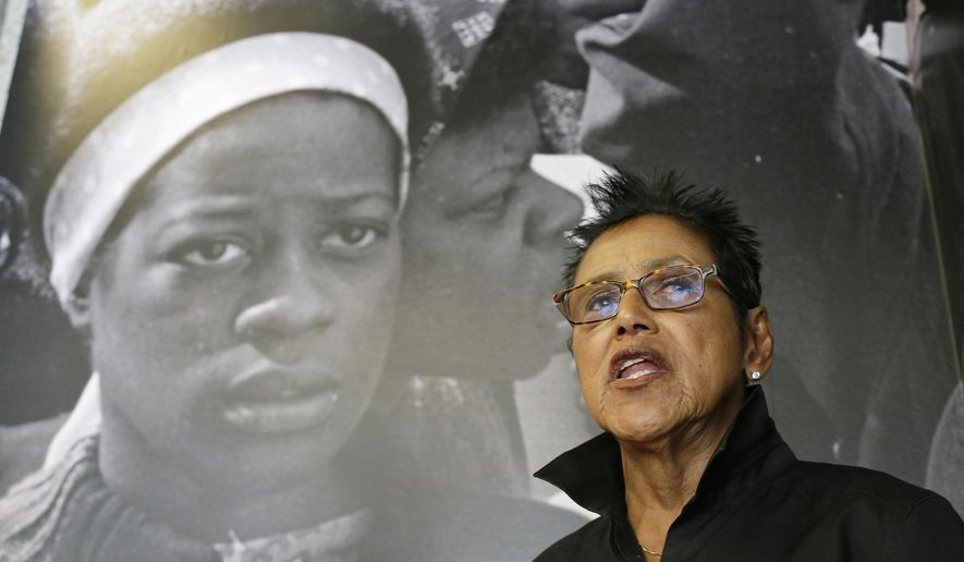 FILE- In this Oct. 8, 2016 file photo, former Black Panther Party leader Elaine Brown answers questions outside a museum in Oakland, Calif. A Northern California jury has awarded more than $4 million in punitive damages to Brown, who was injured after Oakland councilwoman Desley Brooks pushed her during an argument over housing in 2015. (AP Photo/Eric Risberg, File)