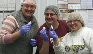 In this Dec. 19, 2017, photo, Jackie Ohmann, from left, Deeann Lufkin and Kathy Hupf pose for a photo in Cannon Falls, Minn. CannonBelles started with Ohmann and Deeann, making 20-minute mozzarella at home. After recruiting Hupf to join, the three women are making local, homemade cheeses that are competing in top competition. (Matthew Lambert/The Rochester Post-Bulletin via AP)