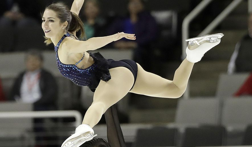 FILE--In this Jan. 4, 2018, file photo, Marissa Castelli, top, and Mervin Tran perform during the pairs short program at the U.S. Figure Skating Championships in San Jose, Calif. Castelli had two pricey costumes and her skates stolen from a rental SUV while visiting San Francisco. (AP Photo/Marcio Jose Sanchez, file)