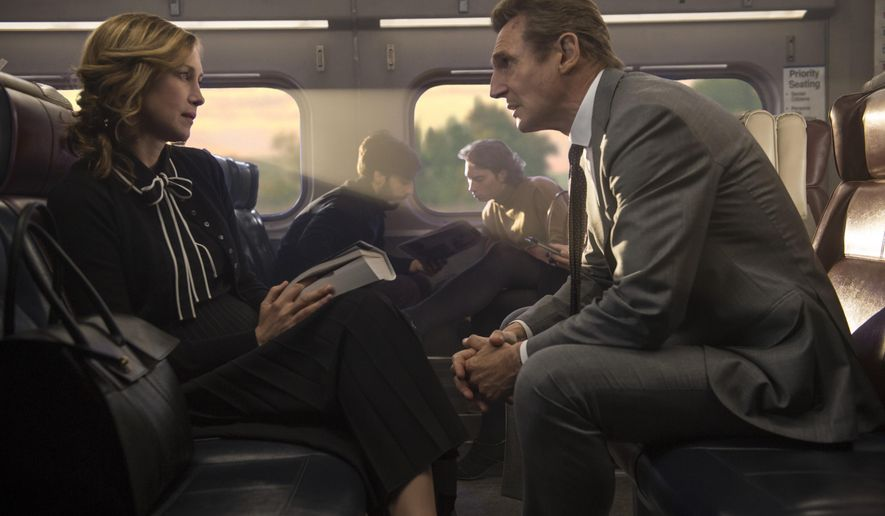 """This image released by Lionsgate shows Vera Farmiga, left, and Liam Neeson in a scene from """"The Commuter."""" (Jay Maidment/Lionsgate via AP)"""
