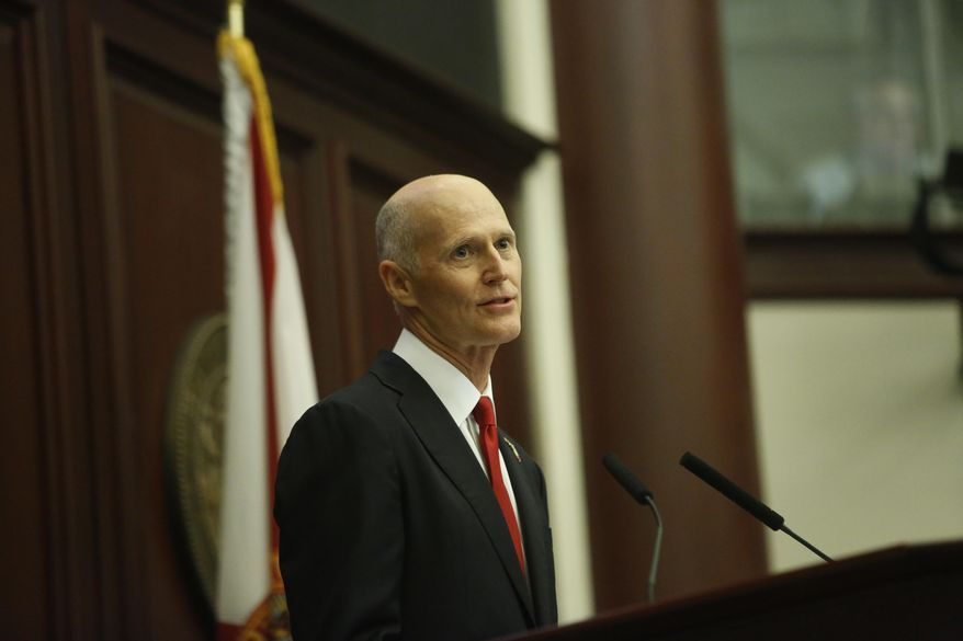 Florida Gov. Rick Scott delivers his State of the State Address in the House chambers on the opening day of the legislative session, Tuesday, Jan. 9, 2018, in Tallahassee, Fla. (Hali Tauxe/Tallahassee Democrat via AP)