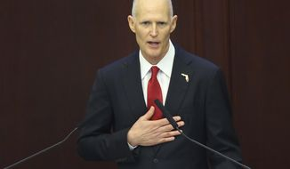Gov. Rick Scott delivers his last State of the State address on the first day of the legislative session, Tuesday, Jan. 9, 2018, in Tallahassee, Fla. (AP Photo/Steve Cannon)
