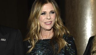 FILE - In this Jan. 7, 2018 file photo, actress and singer Rita Wilson attends the 75th annual Golden Globe Awards in Beverly Hills, Calif. Performing rights organization BMI said Tuesday, Jan. 9, that Wilson, singer-songwriter Craig Wedren and pop singer Morgan Saint will perform at its 16th annual Snowball on Jan. 23 at The Shop at Park City, Utah. (Photo by Chris Pizzello/Invision/AP, File)