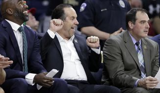 Notre Dame coach Mike Brey celebrates on the bench in the closing minutes of the team's NCAA college basketball game against North Carolina State in South Bend, Ind., Wednesday, Jan. 3, 2018. Notre Dame defeated North Carolina State 88-58, giving Brey his 394th win to become the all-time winningest coach at Notre Dame. (AP Photo/Michael Conroy)