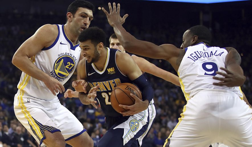 Denver Nuggets' Jamal Murray, center, drives the ball between Golden State Warriors' Zaza Pachulia, left, and Andre Iguodala (9) during the first half of an NBA basketball game Monday, Jan. 8, 2018, in Oakland, Calif. (AP Photo/Ben Margot)