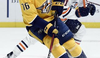 Nashville Predators defenseman P.K. Subban (76) gets control of the puck as Edmonton Oilers left wing Drake Caggiula, right, defends during the first period of an NHL hockey game Tuesday, Jan. 9, 2018, in Nashville, Tenn. (AP Photo/Mark Zaleski)
