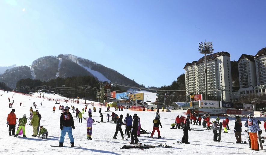 In this Dec. 19, 2017, photo, people take to the slopes at Yongpyong Resort in Pyeongchang, South Korea. South Korea is one of the safest places in the world to live and visit. The Pyeongchang Olympics are coming to a remote, ruggedly beautiful part of South Korea known for icy wind, towering granite mountains and a tough, proud population waiting to welcome foreign hordes. (AP Photo/Ahn Young-joon)