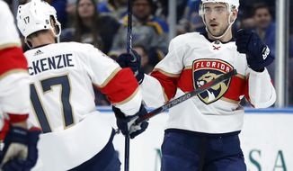 Florida Panthers' Colton Sceviour, right, is congratulated by Derek MacKenzie (17) after scoring during the third period of an NHL hockey game against the St. Louis Blues Tuesday, Jan. 9, 2018, in St. Louis. The Panthers won 7-4. (AP Photo/Jeff Roberson)