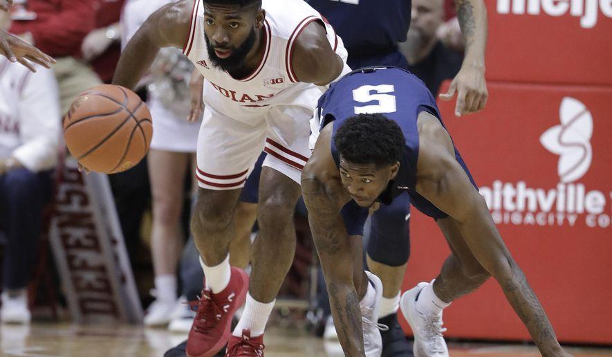 Indiana's Robert Johnson, left, and Penn State's Jamari Wheeler eye a loose ball during the first half of an NCAA college basketball game Tuesday, Jan. 9, 2018, in Bloomington, Ind. (AP Photo/Darron Cummings)