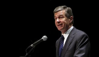 This file photo taken Dec. 19, 2017, shows Gov. Roy Cooper announcing that Triangle Tire Company will be building a manufacturing facility at the Kingsboro megasite in Edgecombe County in Tarboro, N.C. (Alan Campbell/The Rocky Mount Telegram via AP)
