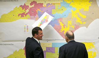FILE - In this Feb. 16, 2016, file photo, Republican state Sens. Dan Soucek, left, and Brent Jackson, right, review historical maps during The Senate Redistricting Committee for the 2016 Extra Session in the Legislative Office Building at the N.C. General Assembly, in Raleigh, N.C. Federal judges ruled Tuesday, Jan. 9, 2018, that North Carolina's congressional district map drawn by legislative Republicans is illegally gerrymandered because of excessive partisanship that gave GOP a rock-solid advantage for most seats and must quickly be redone. (Corey Lowenstein/The News & Observer via AP, File)