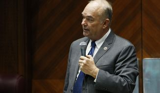 Rep. Don Shooter, R-Yuma, reads a statement regarding sexual harassment and other misconduct complaints made against him by Rep. Michelle Ugenti-Rita and others, as he spoke prior to Arizona House members receiving mandatory sexual harassment and other ethics issues training on the House floor at the Capitol, Tuesday, Jan. 9, 2018, in Phoenix. (AP Photo/Ross D. Franklin)