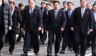 The head of North Korean delegation Ri Son Gwon, second from left, arrives at the South side for the meeting with South Korea at the Panmunjom in the Demilitarized Zone in Paju, South Korea, Tuesday, Jan. 9, 2018. Senior officials from the rival Koreas said Tuesday they would try to achieve a breakthrough in their long-strained ties as they sat for rare talks at the border to discuss how to cooperate in next month's Winter Olympics in the South and other issues. (Korea Pool via AP)