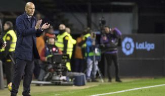 Madrid's coach Zinedine Zidane gestures during a Spanish La Liga soccer match between RC Celta and Real Madrid at the Balaidos stadium in Vigo, Spain, Sunday, Jan. 7, 2018. (AP Photo/Lalo R. Villar)