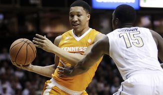 Tennessee forward Grant Williams, left, drives against Vanderbilt forward Clevon Brown (15) during the first half of an NCAA college basketball game Tuesday, Jan. 9, 2018, in Nashville, Tenn. (AP Photo/Mark Humphrey)