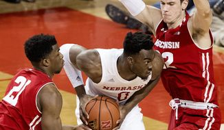 Nebraska center Duby Okeke (0) is defended by Wisconsin forward Ethan Happ (22) and forward Khalil Iverson (21) during the first half of an NCAA college basketball game, Tuesday, Jan. 9, 2018 in Lincoln, Neb. (Francis Gardler/The Journal-Star via AP)