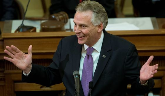 """""""My team has worked with all three branches of government to finalize a process that we have used to restore the rights of more than 173,000 Virginians,"""" said Gov. Terry McAuliffe in his final State of the Commonwealth address. (Associated Press)"""