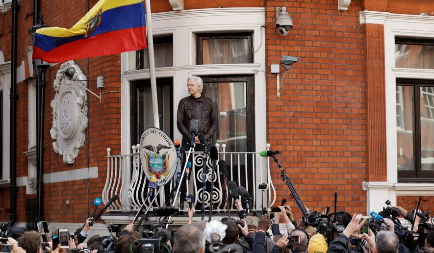 WikiLeaks founder Julian Assange looks out on the balcony of the Ecuadorian embassy prior to speaking, in London, Friday May 19, 2017. Assange has won his battle against extradition to Sweden, which wanted to question him about a rape allegation. He has spent nearly five years inside the Embassy of Ecuador in London to avoid being sent to Sweden, which announced Friday that the investigation has been discontinued. (AP Photo/Matt Dunham)