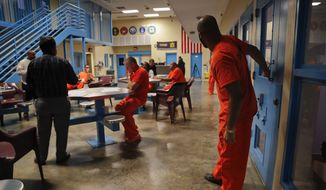 Inmates inside the veteran's pod take a break during a session with Soldier On Chaplain Quentin Chin, left, at the Albany County Correctional Facility, Monday, Nov. 27, 2017, in Albany, N.Y. Albany County's jail devotes one of its housing units for veterans, an increasingly common feature of state and county lockups as the criminal justice system focuses more on helping them reintegrate into society. (AP Photo/Julie Jacobson)