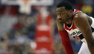 Washington Wizards guard John Wall (2) pauses on the court during the second half of an NBA basketball game against the Utah Jazz, Wednesday, Jan. 10, 2018, in Washington. The Jazz won 107-104. (AP Photo/Alex Brandon)