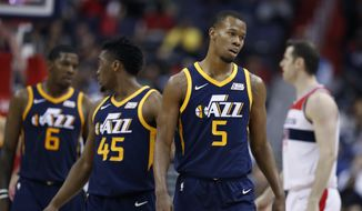 Utah Jazz guard Rodney Hood (5) leaves the court after his second technical foul, forcing his ejection during the second half of an NBA basketball game against the Washington Wizards, Wednesday, Jan. 10, 2018, in Washington. The Jazz won 107-104. (AP Photo/Alex Brandon)
