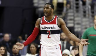 Washington Wizards guard John Wall (2) reacts after a play during the second half of an NBA basketball game against the Utah Jazz, Wednesday, Jan. 10, 2018, in Washington. The Jazz won 107-104. (AP Photo/Alex Brandon)