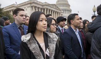 """Dreamers,"" people brought to the U.S. illegally as children, and other supporters of the Deferred Action for Childhood Arrivals program, listen as lawmakers speak at the Capitol in Washington, Wednesday, Jan. 10, 2018. (AP Photo/J. Scott Applewhite)"