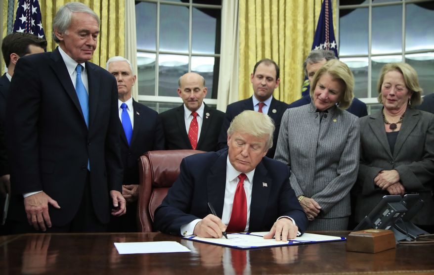 President Donald Trump signs into law the bipartisan Interdict Act to curtail opioids trafficking, during a ceremony in the Oval Office of the White House in Washington, Wednesday, Jan. 10, 2018. The law will provide Customs and Border Protection the latest in chemical screening devices and scientific support to detect and intercept fentanyl and other synthetic opioids at the border. (AP Photo/Manuel Balce Ceneta)