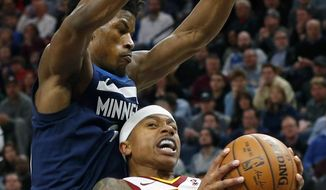 Cleveland Cavaliers' Isaiah Thomas, right, leans back into Minnesota Timberwolves' Jimmy Butler in the second half of an NBA basketball game Monday, Jan. 8, 2018, in Minneapolis. (AP Photo/Jim Mone)