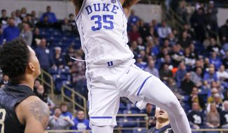 Duke's Marvin Bagley III dunks in front of Pittsburgh's Shamiel Stevenson, left, during the first half of an NCAA college basketball game Wednesday, Jan. 10, 2018, in Pittsburgh. (AP Photo/Keith Srakocic)