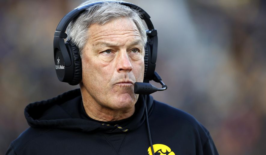 FILE - In this Nov. 18, 2017, file photo, Iowa head coach Kirk Ferentz watches from the sideline during an NCAA college football game in Iowa City, Iowa. Ferentz is facing a challenge in the off-season from his Iowa neighbors. After years of disagreements, trial is scheduled in February in a lawsuit that pits Ferentz and his wife against the three other families who live along a private road outside Iowa City. A judge is expected to hear testimony and decide whether the Ferentzes have breached a 2001 legal agreement and trespassed by planting trees that protrude onto Saddle Club Road. (AP Photo/Charlie Neibergall, File)