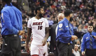Miami Heat forward James Johnson (16) is ejected from the game along with Toronto Raptors forward Serge Ibaka, not seen, during the second half of an NBA basketball game Tuesday, Jan. 9, 2018, in Toronto. (Nathan Denette/The Canadian Press via AP)