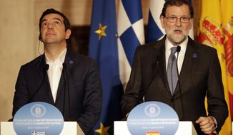 Greek Prime Minister Alexis Tsipras, left, and Spain Prime Minister Mariano Rajoy meet the media during a joint press conference at the Southern Europe summit in Rome, Wednesday, Jan. 10, 2018. A Southern European meeting is taking place at Villa Madama in Rome with leaders of Cyprus, France, Greece, Italy, Malta, Portugal and Spain. (AP Photo/Alessandra Tarantino)