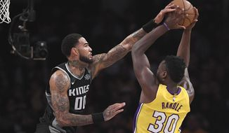 Sacramento Kings center Willie Cauley-Stein, left, blocks the shot of Los Angeles Lakers forward Julius Randle during the first half of an NBA basketball game Tuesday, Jan. 9, 2018, in Los Angeles. (AP Photo/Mark J. Terrill)