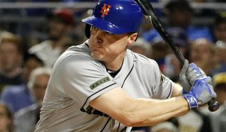 FILE - In this Sunday, May 28, 2017 file photo, New York Mets' Jay Bruce drives in two runs with a double off Pittsburgh Pirates starting pitcher Tyler Glasnow in the fifth inning of a baseball game in Pittsburgh. Two people familiar with the negotiations say free-agent outfielder Jay Bruce is set to return to the New York Mets after agreeing to a $39 million, three-year contract. The people spoke on condition of anonymity Wednesday, Jan. 10, 2018 because the deal is pending a physical and no announcement had been made. (AP Photo/Gene J. Puskar, File)
