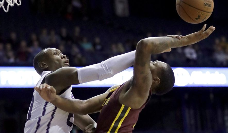 Northwestern guard Scottie Lindsey, left, blocks a shot by Minnesota guard Dupree McBrayer during the first half of an NCAA college basketball game Wednesday, Jan. 10, 2018, in Rosemont, Ill. (AP Photo/Nam Y. Huh)