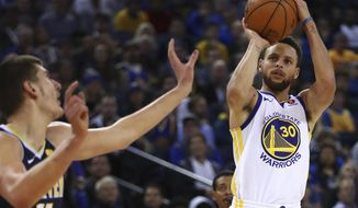 Golden State Warriors' Stephen Curry, right, shoots against Denver Nuggets' Nikola Jokic (15) during the second half of an NBA basketball game Monday, Jan. 8, 2018, in Oakland, Calif. Golden State won, 124-114. (AP Photo/Ben Margot)