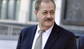 FILE - In this Nov. 24, 2015, file photo, former Massey Energy CEO Don Blankenship walks out of the Robert C. Byrd U.S. Courthouse after the jury deliberated for a fifth full day in his trial in Charleston, W.Va. Blankenship, a former coal company CEO who went to prison, is hosting a town hall meeting for voters next week as he revs up his U.S. Senate candidacy. Blankenship's campaign said in a news release Wednesday, Jan. 10, 2018 the meeting will be Jan. 18 at the Chief Logan Lodge, Hotel and Conference Center in Logan. (AP Photo/Chris Tilley, File)
