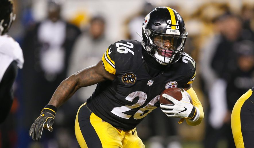 FILE - In this Sunday, Dec. 10, 2017, file photo, Pittsburgh Steelers running back Le'Veon Bell (26) plays in an NFL football game against the Baltimore Ravens in Pittsburgh. The running back is fresh heading into Sunday's playoff game against Jacksonville. Bell only had 15 carries in the teams' first meeting this season. (AP Photo/Keith Srakocic, File)