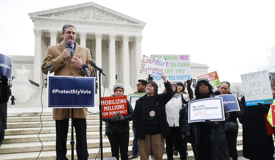 Rep. Tim Ryan, D-Ohio, left, speaks to a rally of people in opposition to Ohio's voter roll purges, outside of the Supreme Court, Wednesday, Jan. 10, 2018, in Washington. (AP Photo/Jacquelyn Martin) ** FILE **