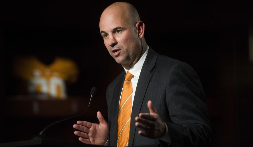 FILE - In this Dec. 7, 2017, file photo, Tennessee head coach Jeremy Pruitt speaks at his introduction ceremony in Knoxville, Tenn. Pruitt doesn't have to split time between two jobs anymore. After serving as Alabama's defensive coordinator during the Crimson Tide's national championship run, Pruitt is back in Knoxville beginning the challenge of returning Tennessee to Southeastern Conference contention. (Caitie McMekin/Knoxville News Sentinel via AP, File)
