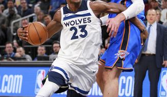 Minnesota Timberwolves guard Jimmy Butler drives on Oklahoma City Thunder center Steven Adams (12) during the second quarter of an NBA basketball game Wednesday, Jan. 10, 2018, in Minneapolis. (AP Photo/Andy Clayton-King)