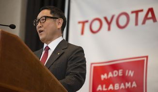 Akio Toyoda, Toyota Motor Corp. president, speaks during a press conference, Wednesday, Jan. 10, 2018, in Montgomery, Ala., where the Japanese automakers Toyota and Mazda announced plans to build a huge $1.6 billion joint-venture plant in Huntsville, that will eventually employ about 4,000 people. Several states had competed for the coveted project, which will be able to turn out 300,000 vehicles per year and will produce the Toyota Corolla compact car for North America and a new small SUV from Mazda.  (Albert Cesare/The Montgomery Advertiser via AP)