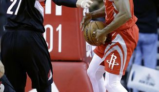 Portland Trail Blazers center Jusuf Nurkic (27) reaches for the rebound caught by Houston Rockets guard Chris Paul (3) Noah Vonleh during the first half of an NBA basketball game Wednesday, Jan. 10, 2018, in Houston. (AP Photo/Michael Wyke)