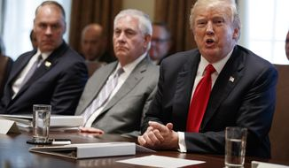 President Donald Trump speaks during a cabinet meeting at the White House, Wednesday, Jan. 10, 2018, in Washington. From left, Secretary of Interior Ryan Zinke, Secretary of State Rex Tillerson, and Trump. (AP Photo/Evan Vucci) **FILE**
