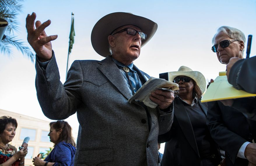 Cliven Bundy refers to his U.S. Constitution while making a point to a reporter following a news conference in front of Metro Police Headquarters on Wednesday, Jan. 10, 2018. (L.E. Baskow/Las Vegas Sun via AP)