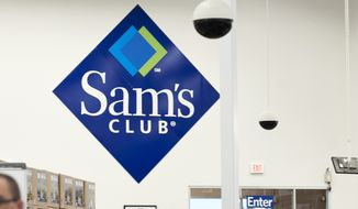 People walk through Sam's Club in Bentonville, Ark., Thursday June 5, 2014. (AP Photo/Sarah Bentham)