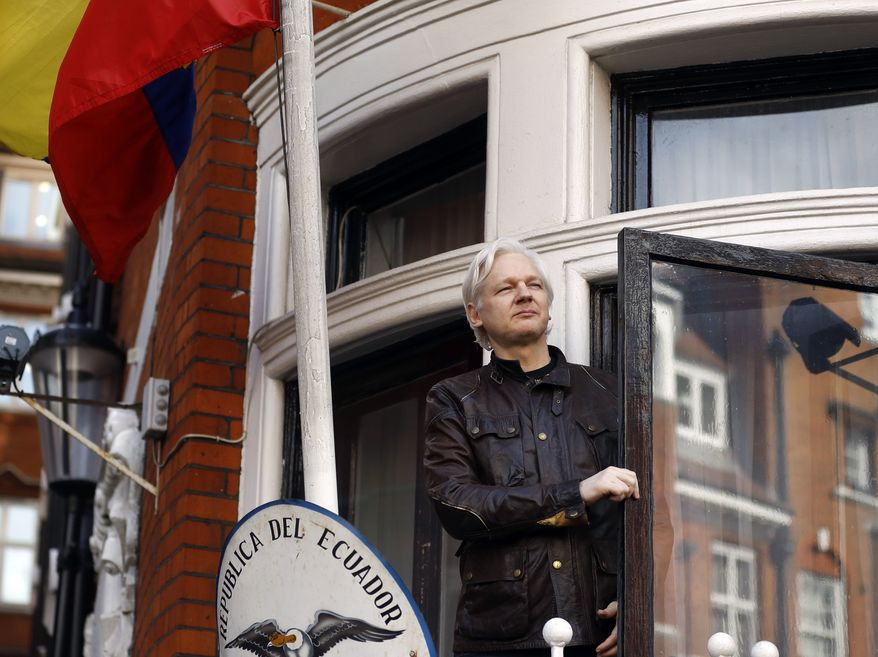 In this Friday May 19, 2017, file photo, WikiLeaks founder Julian Assange greets supporters outside the Ecuadorian embassy in London. (AP Photo/Frank Augstein, File)