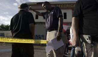 Forensic workers investigate a crime scene where a man was found fatally shot, in San Juan, Puerto Rico, Thursday, Jan. 11, 2018. Hurricane Maria has plunged much of the island into darkness, increased economic hardship and contributed to a sickout by police, all fueling lawlessness. Whats more, officials say a turf war has broken out among drug gangs looking to grab territory after the storms disruption.   (AP Photo/Carlos Giusti)
